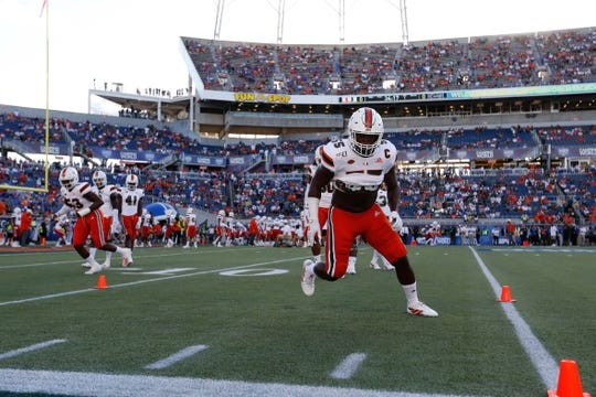 Aug 24, 2019; Orlando, FL, USA; Miami Hurricanes linebacker Shaquille Quarterman (55) and teammates works out prior to the game at Camping World Stadium. Mandatory Credit: Kim Klement-USA TODAY Sports