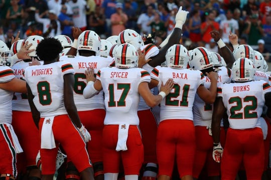 Aug 24, 2019; Orlando, FL, USA; Miami Hurricanes players get pumped up prior to the game at Camping World Stadium. Mandatory Credit: Kim Klement-USA TODAY Sports