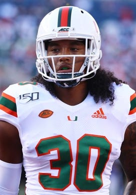 Aug 24, 2019; Orlando, FL, USA; Miami Hurricanes linebacker Romeo Finley (30) works out prior to the game at Camping World Stadium. Mandatory Credit: Kim Klement-USA TODAY Sports
