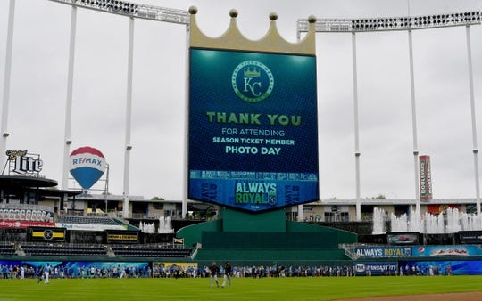 Sep 1, 2019; Kansas City, MO, USA; Kansas City Royals fans and season ticket holders line the warning track for photos with the players before a game against the Baltimore Orioles at Kauffman Stadium. Mandatory Credit: Denny Medley-USA TODAY Sports