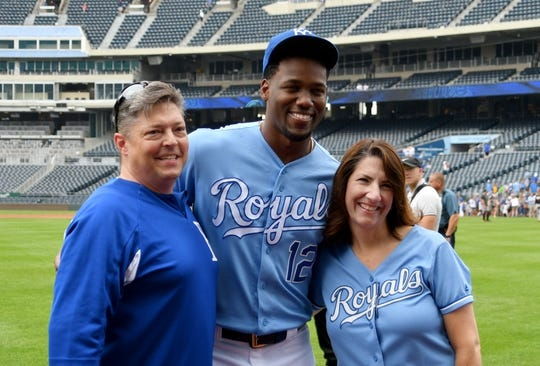 Sep 1, 2019; Kansas City, MO, USA; Kansas City Royals designated hitter Jorge Soler (12) poses for a photo with fans on the warning track before a game against the Baltimore Orioles at Kauffman Stadium. Mandatory Credit: Denny Medley-USA TODAY Sports