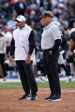 Sep 9, 2019; Oakland, CA, USA; Oakland Raiders head coach Jon Gruden (right) and special teams coordinator Rich Bisacia talk before the game against the Denver Broncos at Oakland Coliseum. Mandatory Credit: Kirby Lee-USA TODAY Sports