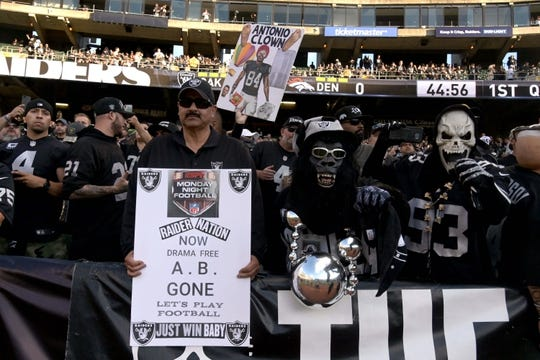 Sep 9, 2019; Oakland, CA, USA; Oakland Raiders fans hold signs referring to the release of receiver Antonio Brown (not pictured) during the game against the Denver Broncos at Oakland Coliseum. Mandatory Credit: Kirby Lee-USA TODAY Sports