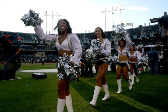 Sep 9, 2019; Oakland, CA, USA; Oakland Raiders Raiderette cheerleaders acknowledge the crowd during the game against the Oakland Raiders at Oakland Coliseum. Mandatory Credit: Kirby Lee-USA TODAY Sports