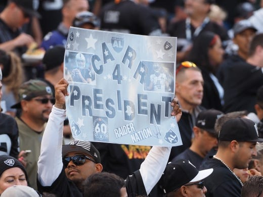 Sep 9, 2019; Oakland, CA, USA; An Oakland Raiders fan holds a sign  Carr 4 President  referring the quarterback Derek Carr (not pictured) before the game against the Denver Broncos at Oakland Coliseum. Mandatory Credit: Kelley L Cox-USA TODAY Sports