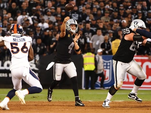 Sep 9, 2019; Oakland, CA, USA; Oakland Raiders quarterback Derek Carr (4) passes the ball against the Denver Broncos during the first quarter at Oakland Coliseum. Mandatory Credit: Kelley L Cox-USA TODAY Sports