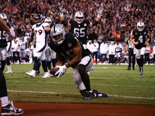 Sep 9, 2019; Oakland, CA, USA; Oakland Raiders wide receiver Tyrell Williams (16) scores a touchdown against the Denver Broncos during the first quarter at Oakland Coliseum. Mandatory Credit: Kelley L Cox-USA TODAY Sports
