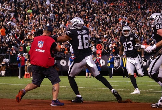 Sep 9, 2019; Oakland, CA, USA; Oakland Raiders wide receiver Tyrell Williams (16) celebrates after a touchdown against the Denver Broncos during the first quarter at Oakland Coliseum. Mandatory Credit: Kelley L Cox-USA TODAY Sports