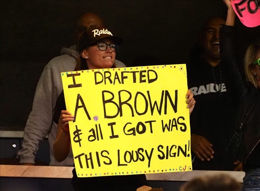 Sep 9, 2019; Oakland, CA, USA; An Oakland Raiders fan holds a sign referring to the release of receiver Antonio Brown (not pictured) during the first quarter against the Denver Broncos at Oakland Coliseum. Mandatory Credit: Kelley L Cox-USA TODAY Sports