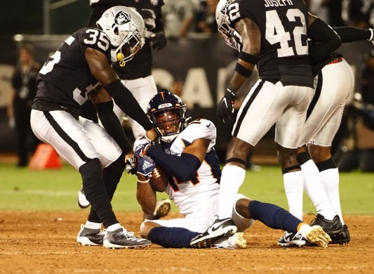 Sep 9, 2019; Oakland, CA, USA; Denver Broncos wide receiver Courtland Sutton (14) holds onto the ball after a play against the Oakland Raiders during the first quarter at Oakland Coliseum. Mandatory Credit: Kelley L Cox-USA TODAY Sports