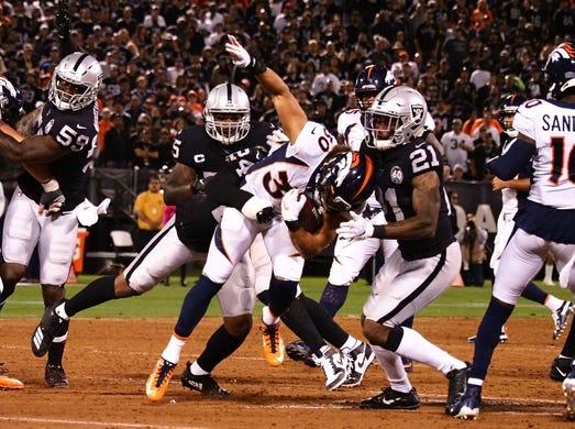 Sep 9, 2019; Oakland, CA, USA; Oakland Raiders defensive back Johnathan Abram (24) tackles Denver Broncos running back Phillip Lindsay (30) during the second quarter at Oakland Coliseum. Mandatory Credit: Kelley L Cox-USA TODAY Sports