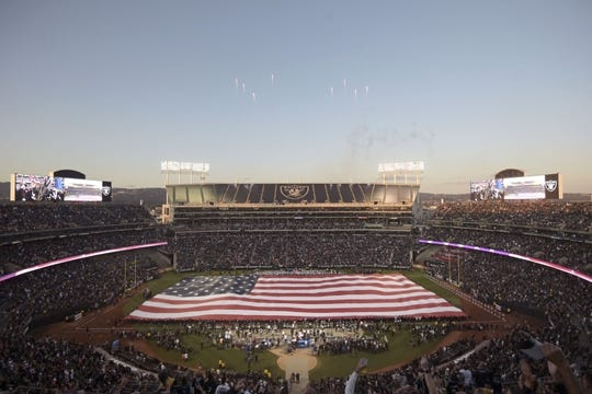 Sep 9, 2019; Oakland, CA, USA; General overall view of the Oakland-Alameda County Coliseum with a United States flag during the playing of the national anthem before the NFL game between the against the Denver Broncos and the against the Oakland Raiders. Mandatory Credit: Kirby Lee-USA TODAY Sports
