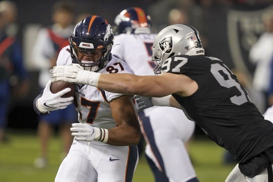 Sep 9, 2019; Oakland, CA, USA; Denver Broncos tight end Noah Fant (87) is defended by Oakland Raiders defensive end Josh Mauro (97) jn the first qauretrat Oakland-Alameda County Coliseum. Mandatory Credit: Kirby Lee-USA TODAY Sports