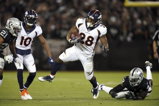 Sep 9, 2019; Oakland, CA, USA; Denver Broncos running back Royce Freeman (28) is pursued by Oakland Raiders free safety Karl Joseph (42) at Oakland-Alameda County Coliseum. The Raiders defeated The Broncos 24-16.  Mandatory Credit: Kirby Lee-USA TODAY Sports