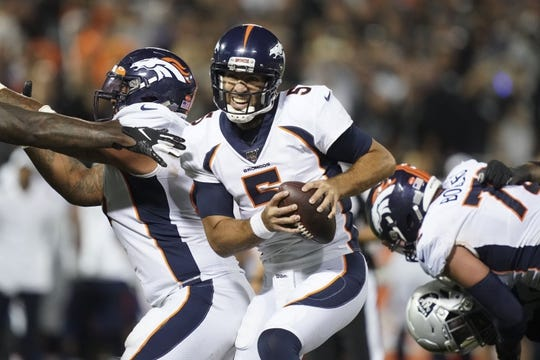 Sep 9, 2019; Oakland, CA, USA; Denver Broncos quarterback Joe Flacco (5) scrambles in the second half against the Oakland Raiders  at Oakland-Alameda County Coliseum. The Raiders defeated The Broncos 24-16.  Mandatory Credit: Kirby Lee-USA TODAY Sports