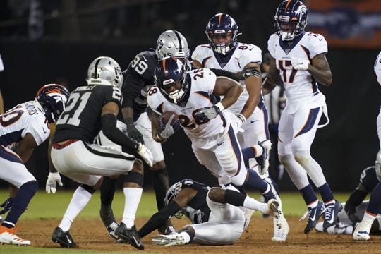 Sep 9, 2019; Oakland, CA, USA; Denver Broncos running back Royce Freeman (28) carries the ball in the second half against the Oakland Raiders at Oakland-Alameda County Coliseum. The Raiders defeated The Broncos 24-16.  Mandatory Credit: Kirby Lee-USA TODAY Sports
