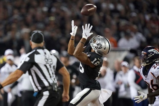Sep 9, 2019; Oakland, CA, USA; Oakland Raiders wide receiver Tyrell Williams (16) catches the ball as Denver Broncos cornerback Isaac Yiadom (26) defends in the second quarter at Oakland-Alameda County Coliseum. Mandatory Credit: Kirby Lee-USA TODAY Sports