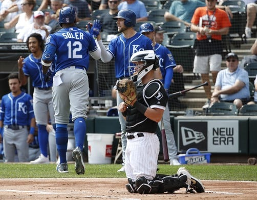 Sep 12, 2019; Chicago, IL, USA; Kansas City Royals right fielder Jorge Soler (12) celebrates with third baseman Hunter Dozier (17) after hitting a solo home run against the Chicago White Sox during the first inning at Guaranteed Rate Field. Mandatory Credit: Kamil Krzaczynski-USA TODAY Sports