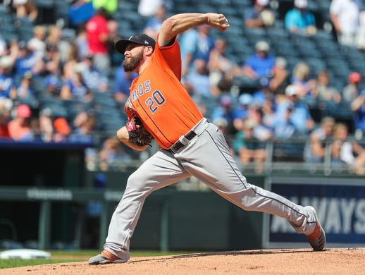 Sep 15, 2019; Kansas City, MO, USA; Houston Astros starting pitcher Wade Miley (20) pitches against the Kansas City Royals during the first inning at Kauffman Stadium. Mandatory Credit: Jay Biggerstaff-USA TODAY Sports