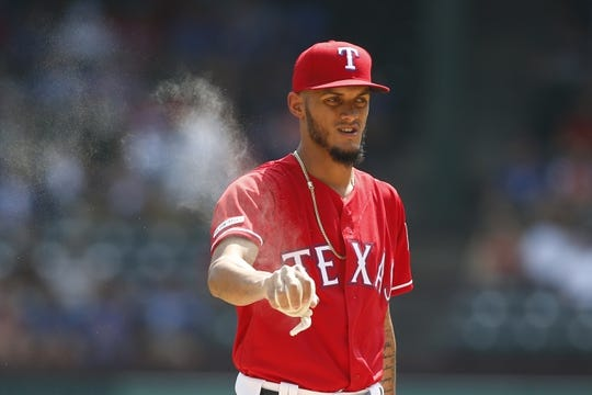 Sep 15, 2019; Arlington, TX, USA; Texas Rangers starting pitcher Jonathan Hernandez (72) grabs the rosin bag on the mound in the first inning against the Oakland Athletics at Globe Life Park in Arlington. Mandatory Credit: Tim Heitman-USA TODAY Sports