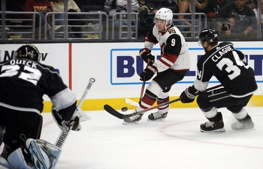 September 17, 2019; Los Angeles, CA, USA; Arizona Coyotes right wing Clayton Keller (9) moves in for a shot on goal against Los Angeles Kings defenseman Kale Clague (34) and goaltender Jonathan Quick (32) during the first period at Staples Center. Mandatory Credit: Gary A. Vasquez-USA TODAY Sports