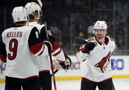 September 17, 2019; Los Angeles, CA, USA; Arizona Coyotes right wing Conor Garland (83) celebrates with center Christian Dvorak (18) and right wing Clayton Keller (9) his goal scored against the Los Angeles Kings during the third period at Staples Center. Mandatory Credit: Gary A. Vasquez-USA TODAY Sports