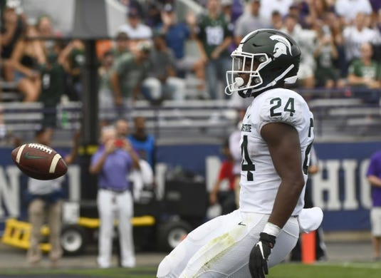 Sep 21, 2019; Evanston, IL, USA; Michigan State Spartans running back Elijah Collins (24) scores a touchdown against the Northwestern Wildcats during the first half at Ryan Field. Mandatory Credit: Matt Marton-USA TODAY Sports