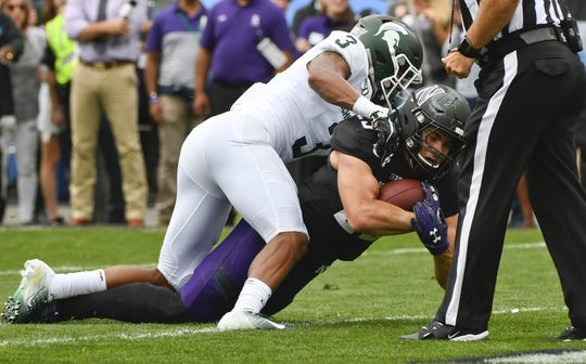 Sep 21, 2019; Evanston, IL, USA; Michigan State Spartans safety Xavier Henderson (3) stops Northwestern Wildcats running back Isaiah Bowser (25) at the one yard line during the first half at Ryan Field. Mandatory Credit: Matt Marton-USA TODAY Sports