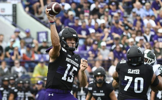 Sep 21, 2019; Evanston, IL, USA; Northwestern Wildcats quarterback Hunter Johnson (15) looks to pass against the Michigan State Spartans during the first half at Ryan Field. Mandatory Credit: Matt Marton-USA TODAY Sports