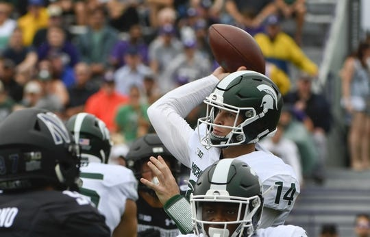 Sep 21, 2019; Evanston, IL, USA; Michigan State Spartans quarterback Brian Lewerke (14) looks to pass against the Northwestern Wildcats during the first half at Ryan Field. Mandatory Credit: Matt Marton-USA TODAY Sports