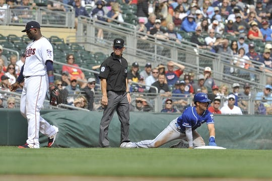 Sep 22, 2019; Minneapolis, MN, USA;  Kansas City Royals left field Whit Merrifield (15) steals third base during the first inning against the Minnesota Twins at Target Field. Mandatory Credit: Marilyn Indahl-USA TODAY Sports