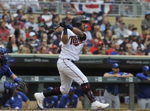Sep 22, 2019; Minneapolis, MN, USA;  Minnesota Twins left fielder Eddie Rosario (20) hits a double during the first inning against the Kansas City Royals at Target Field. Mandatory Credit: Marilyn Indahl-USA TODAY Sports