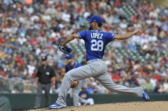 Sep 22, 2019; Minneapolis, MN, USA; Kansas City Royals pitcher Jorge Lopez (28) delivers a pitch during the first inning against the Minnesota Twins  at Target Field. Mandatory Credit: Marilyn Indahl-USA TODAY Sports