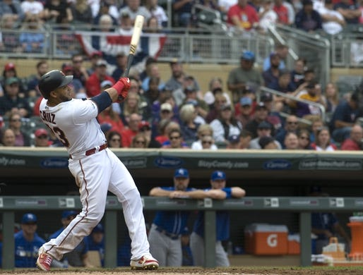 Sep 22, 2019; Minneapolis, MN, USA;  Minnesota Twins designated hitter Nelson Cruz (23) hits his 400th career home run during the fourth inning against the Kansas City Royals at Target Field. Mandatory Credit: Marilyn Indahl-USA TODAY Sports