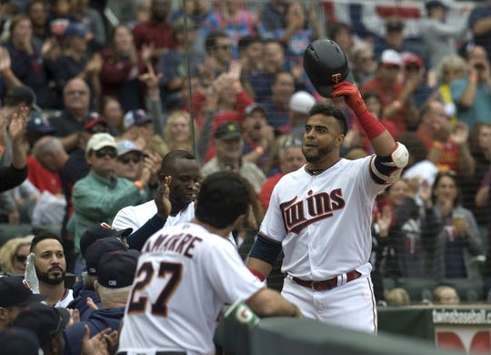 Sep 22, 2019; Minneapolis, MN, USA;  Minnesota Twins designated hitter Nelson Cruz (23) tips his cap to the crowd in after hitting his 400th career home run during the fourth inning against the Kansas City Royals at Target Field. Mandatory Credit: Marilyn Indahl-USA TODAY Sports