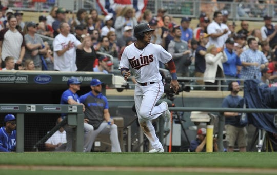 Sep 22, 2019; Minneapolis, MN, USA;  Minnesota Twins shortstop Jorge Polanco (11) scores on a double by left fielder Eddie Rosario (not pictured) against the Kansas City Royals during the first inning at Target Field. Mandatory Credit: Marilyn Indahl-USA TODAY Sports