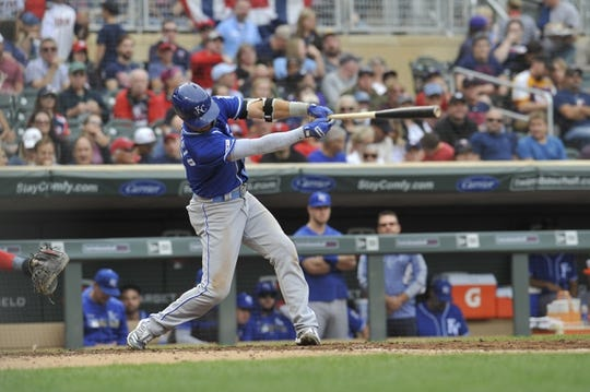 Sep 22, 2019; Minneapolis, MN, USA;  Kansas City Royals left field Whit Merrifield (15) hits a single during the fourth inning against the Minnesota Twins at Target Field. Mandatory Credit: Marilyn Indahl-USA TODAY Sports