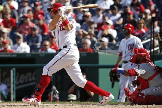 Sep 24, 2019; Washington, DC, USA; Washington Nationals first baseman Ryan Zimmerman (11) hits an RBI single against the Philadelphia Phillies in the sixth inning at Nationals Park. Mandatory Credit: Geoff Burke-USA TODAY Sports