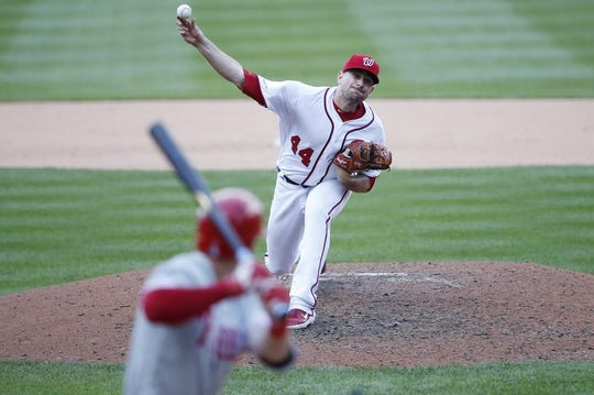 Sep 24, 2019; Washington, DC, USA; Washington Nationals relief pitcher Daniel Hudson (44) pitches against Philadelphia Phillies center fielder Scott Kingery (4) in the ninth inning at Nationals Park. Mandatory Credit: Geoff Burke-USA TODAY Sports