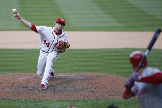 Sep 24, 2019; Washington, DC, USA; Washington Nationals relief pitcher Daniel Hudson (44) pitches against Philadelphia Phillies first baseman Logan Morrison (8) in the ninth inning at Nationals Park. Mandatory Credit: Geoff Burke-USA TODAY Sports