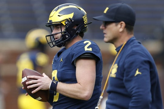 Sep 28, 2019; Ann Arbor, MI, USA; Michigan Wolverines quarterback Shea Patterson (2) warms up near head coach Jim Harbaugh before the game against the Rutgers Scarlet Knights at Michigan Stadium. Mandatory Credit: Raj Mehta-USA TODAY Sports