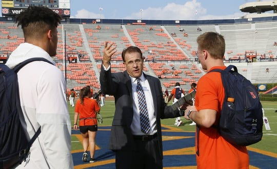 Sep 28, 2019; Auburn, AL, USA; Auburn Tigers head coach Gus Malzahn goes through pre-game preparations with quarterbacks Joey Gatewood (left) and Bo Nix (right) before game between the Auburn Tigers and the Mississippi State Bulldogs at Jordan-Hare Stadium. Mandatory Credit: John Reed-USA TODAY Sports