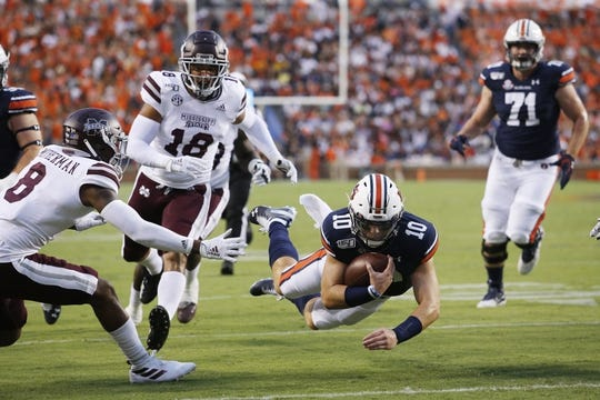 Sep 28, 2019; Auburn, AL, USA;  Auburn Tigers quarterback Bo Nix (10) scores a touchdown against the Mississippi State Bulldogs during the first quarter at Jordan-Hare Stadium. Mandatory Credit: John Reed-USA TODAY Sports