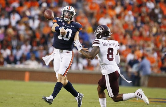 Sep 28, 2019; Auburn, AL, USA;  Auburn Tigers quarterback Bo Nix (10) is pressured by by Mississippi State Bulldogs cornerback Maurice Smitherman (8) during the first quarter at Jordan-Hare Stadium. Mandatory Credit: John Reed-USA TODAY Sports