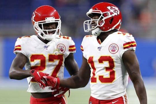 Sep 29, 2019; Detroit, MI, USA; Kansas City Chiefs defensive back Rashad Fenton (27) shakes hands with wide receiver Byron Pringle (13) before the game against the Detroit Lions at Ford Field. Mandatory Credit: Raj Mehta-USA TODAY Sports