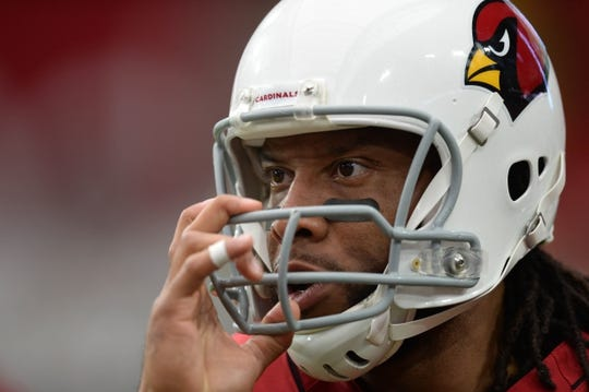 Sep 29, 2019; Glendale, AZ, USA; Arizona Cardinals wide receiver Larry Fitzgerald (11) warms up prior to facing the Seattle Seahawks at State Farm Stadium. Mandatory Credit: Joe Camporeale-USA TODAY Sports