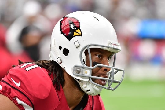 Sep 29, 2019; Glendale, AZ, USA; Arizona Cardinals wide receiver Larry Fitzgerald (11) warms up prior to the game against the Seattle Seahawks at State Farm Stadium. Mandatory Credit: Matt Kartozian-USA TODAY Sports