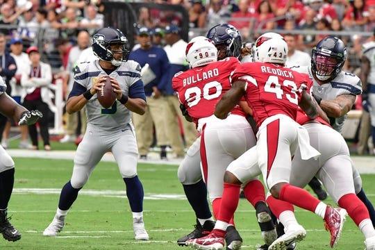 Sep 29, 2019; Glendale, AZ, USA; Seattle Seahawks quarterback Russell Wilson (3) looks to pass during the first half against the Arizona Cardinals at State Farm Stadium. Mandatory Credit: Matt Kartozian-USA TODAY Sports