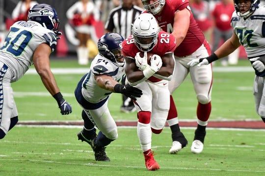 Sep 29, 2019; Glendale, AZ, USA; Arizona Cardinals running back Chase Edmonds (29) runs the ball as Seattle Seahawks middle linebacker Bobby Wagner (54) defends during the first half at State Farm Stadium. Mandatory Credit: Matt Kartozian-USA TODAY Sports