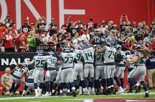 Sep 29, 2019; Glendale, AZ, USA; The Seattle Seahawks celebrate a touchdown against the Arizona Cardinals during the first half at State Farm Stadium. Mandatory Credit: Joe Camporeale-USA TODAY Sports